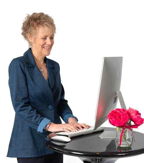 Virtual colour analysis Gail looking at a laptop